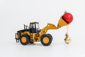 Christmas ornament and Wheel Loader model , Holiday celebration concept new year on white background