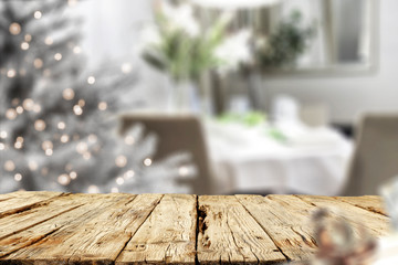 Old wooden table in. Christmas evening and magical time