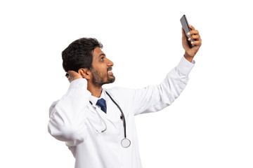 Doctor taking selfie with phone.