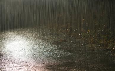 Heavy rain under light at night