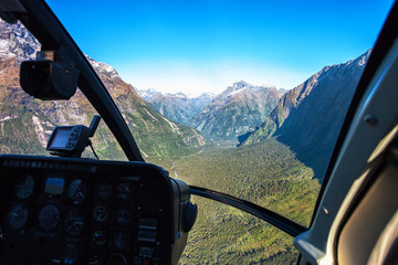 Photo sur Toile Hélicoptère Scenic helicopter flight with view from cockpit, Milford Sound , Fiordland National Park, South Island, New Zealand.