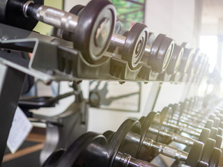 Dumbbells on the rack with light effects