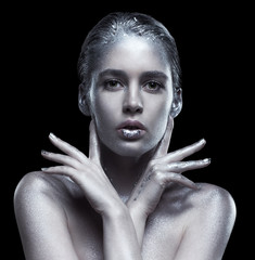 Beauty portrait of young gorgeous woman. Female with hand near face  on black background