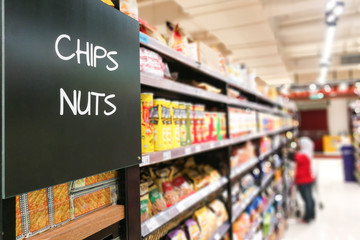 chips and Nuts grocery categoy aisle at supermarket