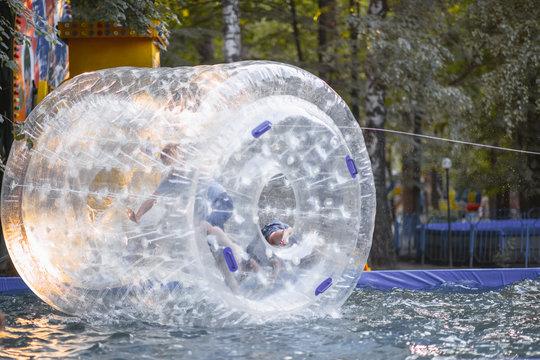 Children's entertainment in the amusement park-running inside the zorb