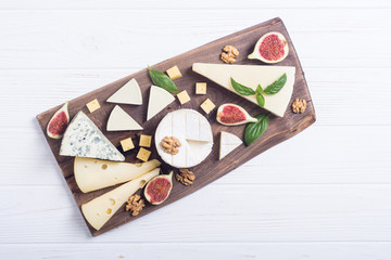Cheeseboard with cheese brie , parmesan , camembert and dorblu