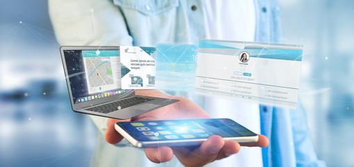 Businessman holding a Website application going out a laptop screen 3d rendering