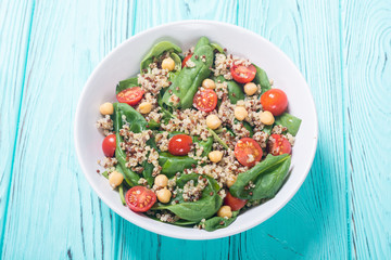 Spinach salad with quinoa , tomatoes and chickpea