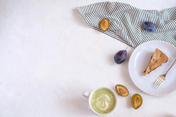 Autumn cosiness concept - Plum pie and tea.
