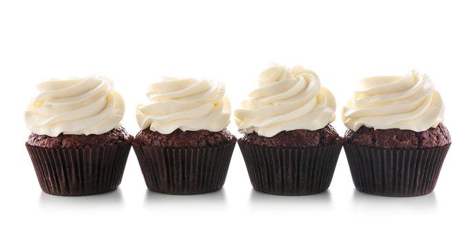 Tasty chocolate cupcakes on white background