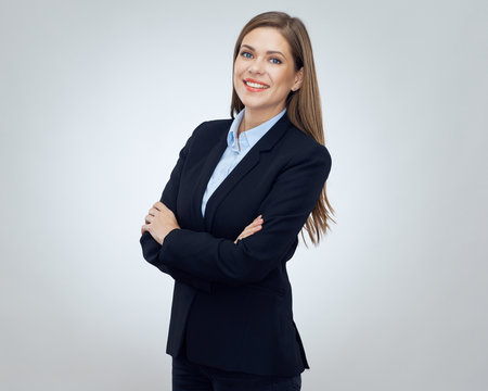 Smiling young business woman wearing black suit