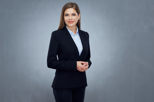 business woman wearing black suit isolated studio portrait.