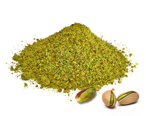 Ground, milled, crushed or granulated pistachio pile from top view isolated on white background