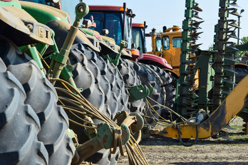 Russia, Temryuk - 15 July 2015: Tractor. Agricultural machinery tractor. Rear wheels of the tractor. The picture was taken at a parking lot of tractors in a rural garage on the outskirts of Temryuk.