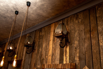 vintage lamps in the old style on the wooden wall