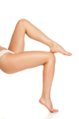Long woman legs with soft skin isolated on white