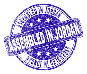 ASSEMBLED IN JORDAN stamp seal watermark with distress texture. Designed with rounded rectangle and circles. Blue vector rubber watermark of ASSEMBLED IN JORDAN tag with dirty texture.