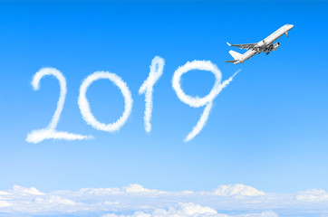 Happy New year 2019 concept. Drawing by airplane vapor contrail in sky.