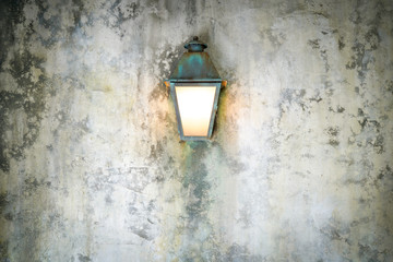Rough cement wall texture background with a lamp