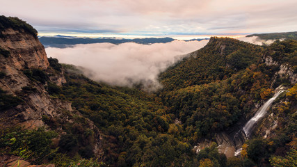 dawns in the fog covered valley in autumn