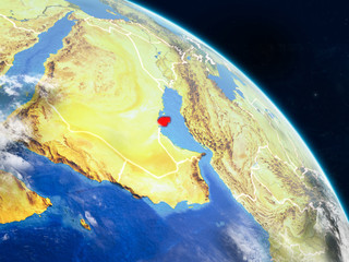 Qatar from space on realistic model of planet Earth with country borders and detailed planet surface and clouds.