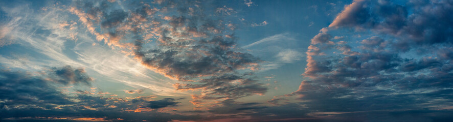 Panorama evening sky with blue, white and orange clouds Fotobehang