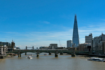 Staande foto London London, UK: River Thames, the Shard Building and the Tower Bridge in the distance