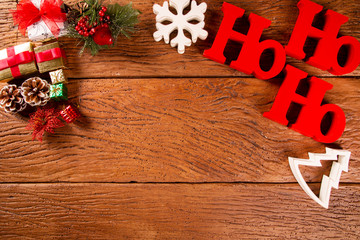 Christmas decorations and ornament on wooden background. View from above