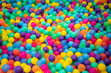 colourful plastic balls background for kid activity in indoor playground.