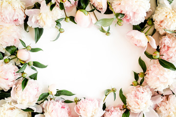 Frame made of beautiful pink peonies on white background. Flat lay, top view. Valentine's background. Floral frame. Peony texture.