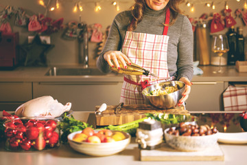 Young Woman Cooking in the kitchen. Healthy Food for Christmas (stuffed duck or Goose)