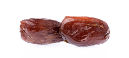 Dried halawi dates isolated on a white background.