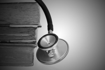 Medical research or ethic concept, Stethoscope with old books