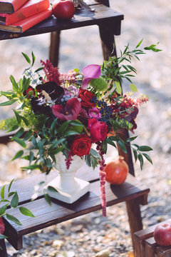 set of autumn wedding decor outdoors. Floral arrangement of flowers and fruits. details of the wedding ceremony. staging for the newlyweds decorator