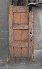 Wooden door to the garage, shed