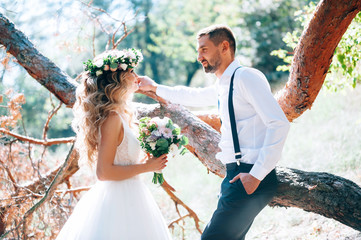 happy bride and groom on nature. Rustic wedding.