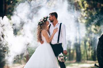 Fototapeta bride and groom on the background of fairy fog in the forest. Rustic wedding concept obraz