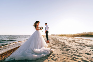 bride and groom on the seashore. wedding concept on the sea, on a fabulous island.