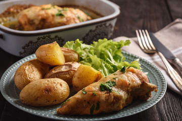 Chicken fillet baked with mozzarella and garlic butter. Served with roasted potatoes.