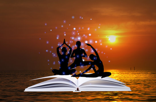 Open book with silhouette of woman practicing yoga