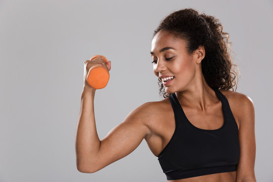 Portrait of an afro american smiling sportswoman