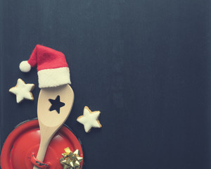 Cooking spoon with hat of santa