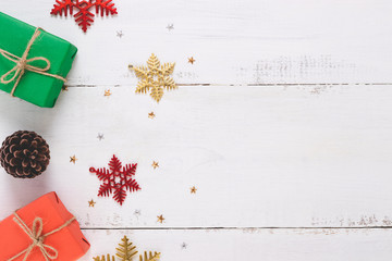 Top view of snowflakes,Christmas gift  ,Pine cones on  wooden white background and copy space.