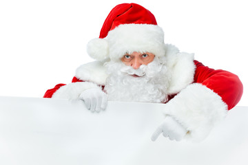 bearded santa claus pointing at blank board isolated on white