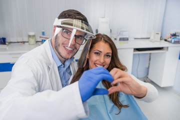 Attractive female patient flirting with doctor, dentist