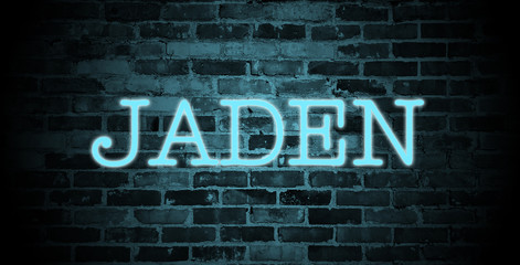 first name Jaden in blue neon on brick wall