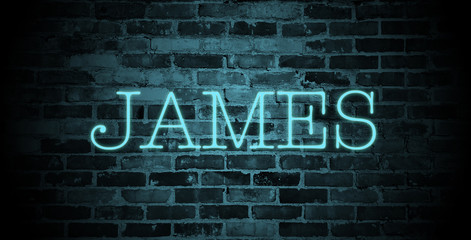 first name James in blue neon on brick wall