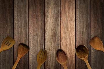 Stripe brown tone wood table surface with wooden utensils. Copy space.