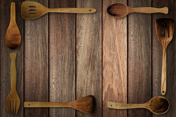 Stripe brown tone wood table surface with wooden utensils around the image. Copy space.