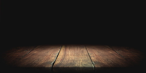 Wood table in the dark background. Wall mural